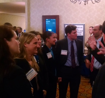 Photo of Duke Law students engaging with DOJ and DOD attorneys at ABA National Security Conference