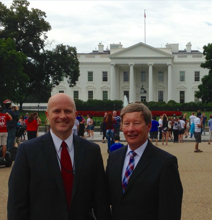Photo of Maj Gen Dunlap with Colonel Bryan Watson in front of the White House.